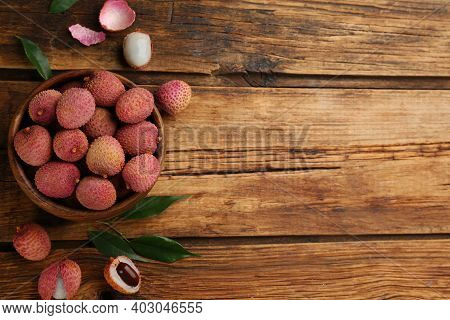 Fresh Ripe Lychee Fruits On Wooden Table, Flat Lay. Space For Text