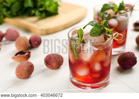 Lychee Cocktail With Mint And Ice On White Table