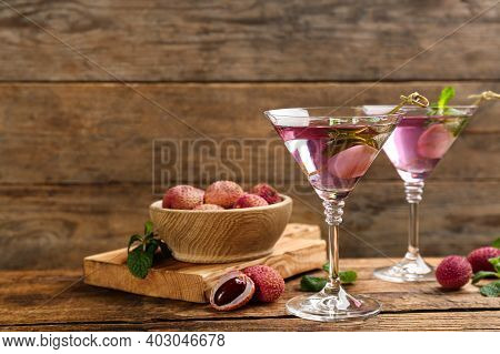 Lychee Cocktail On Wooden Table, Space For Text