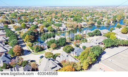 Top View Upscale Lakeside Neighborhood With Colorful Autumn Leaves In Coppell, Texas, Usa