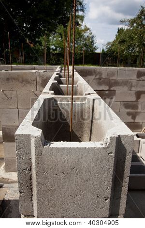 Concrete block of building foundation with steel reinforcement poster