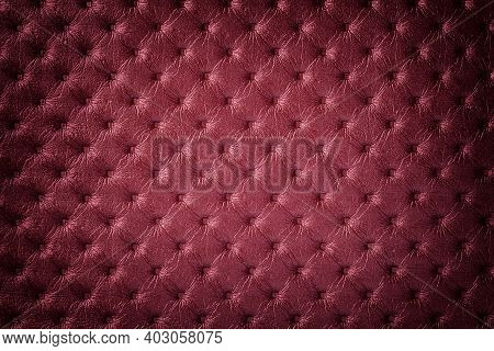 Texture Of Dark Red Leather Background With Capitone Pattern, Macro. Wine Textile Of Retro Chesterfi