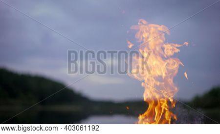 Bonfire By The Lake. Bonfire On The Beach Sand.