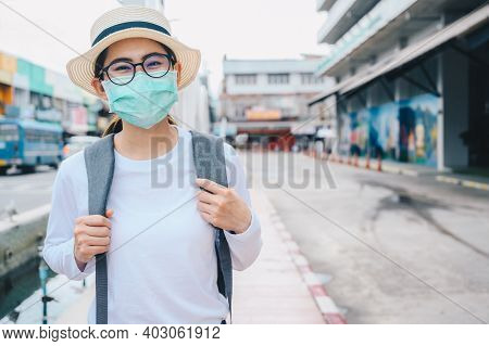 Asian Woman Smiling Behind The Mask While Travel During The Covid-19 Pandemic. During Your Trip Shou