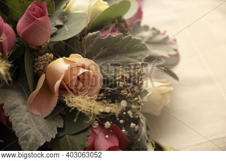 Close Up Of Centerpiece Roses And Foliage