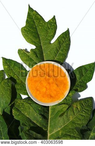 Top View Of Papaya Pulp Or Pawpaw Pulp In A Plate Isolated On Leaf