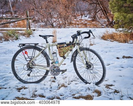 touring bicycle at dusk in late fall or winter scenery on a bike trail in Fort Collins, northern Colorado, recreation and commuting concept