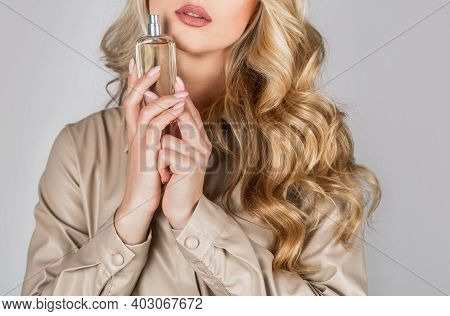 Perfume Bottle Woman Spray Aroma. Woman Holding A Perfumes Bottle. Womans With Perfum Bottle. Beauti