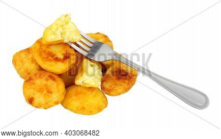 Group Of Crispy Roasted Potatoes Isolated On A White Background