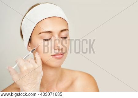Cheek Injection At Spa Salon. Doctor Hands. Pretty Female Patient. Beauty Treatment. Healthy Skin Pr