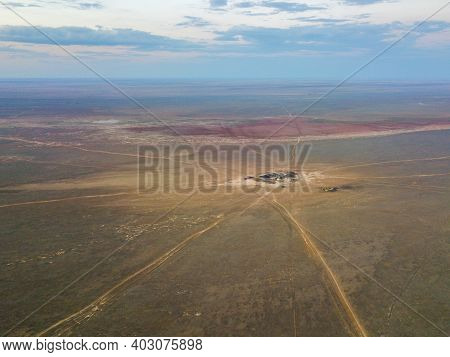 A Lonely Dwelling Or House In The Steppe Or Desert. The Beginning Of The Roads In All Directions