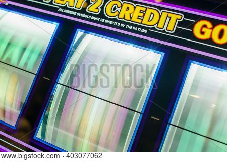 Rotating Three Reels Of The Casino Slot Machine One Handed Bandit Game Close Up. Gambling Industry T