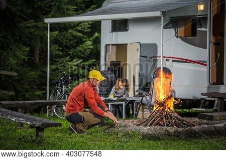 Caucasian Family On The Summer Camping. Father Spending Time Near Campfire. His Daughter Writing Vac