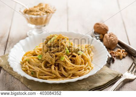 spaghetti with cabbage pesto and nuts
