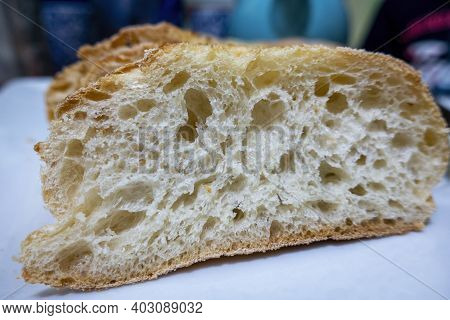 Close-up Of Cross Section Pore Structure Of A Slice Of Fresh Homemade Bread, Formed During The Bakin