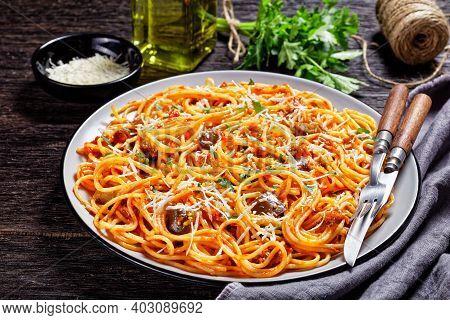 Spaghetti Alla Norma, Sicilian Pasta Dish Of Sauteed Eggplant Tossed With Tomato Sauce And Topped Wi