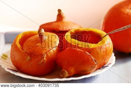 Small Pumpkin Baked And Raw Still Life Halloween Closeup Photo