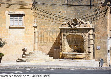 Rabat, Malta - April 3, 2017 - Stone Drinking Fountain Dated 1881 At The Junction Of Triq Repubblika