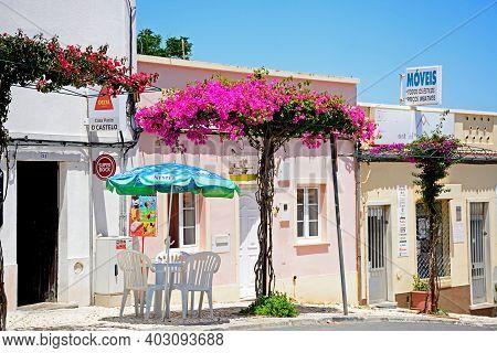 Castro Marim, Portugal - June 11, 2017 - Pavement Cafe Along A Town Street With Pretty Bougainvillea