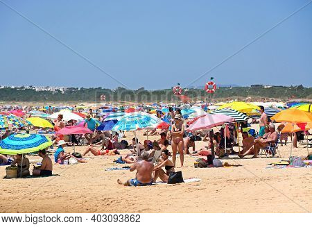 Vila Real De Santo Antonio - June 11, 2017 - Tourists Relaxing On The Beach During The Summertime, P