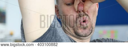 Close-up Of Man After Physical Exertion. Male Person In Tee-shirt With Sweaty Underarm. Sweat On Gre