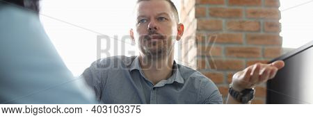 Portrait Of Serious Man Looking At Colleague With Calmness. Businessman Discussing Mistakes And Corr