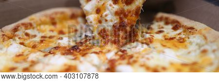 Close-up Of Persons Hand Taking Delicious Slice Of Oven Baked Pizza. Bacon Sausages Double Cheese An