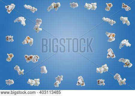 Popcorn Isolated On Blue Background. Falling Or Flying Popcorn. Close-up
