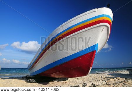 Fishing Boat At Playa Del Carmen Beach During The Sunset. Playa Del Carmen, Quintana Roo, Mexico.som