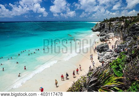 Ocean And Rocky Coast With Lots Of Tourists Walking On The Beach In Tulum, Quintana Roo, Mexico. Som