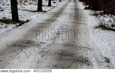 Frozen Paths In The Countryside With A Little Snow And Rocks In The Deep Entrance And In The Alley.