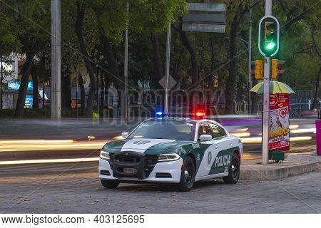 Mexico City - Jan. 17, 2020: Police Car On Duty On Avenida Paseo De La Reforma Avenue At Angel Of In