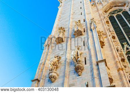Facade Of Milan Cathedral Duomo Di Milano With Gothic Spires And White Marble Statues. Top Tourist A