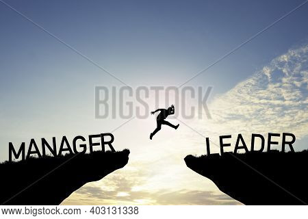 Silhouette Man Jumping From Manager Cliff To Leader Cliff On Cloud And Blue Sky. Change Behaviour An