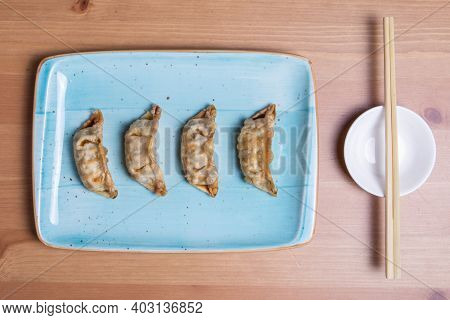 Gyoza Or Dumplings Snack With Soy Sauce, Selective Focus, Copy Space