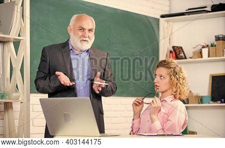 Man Mature School Teacher And Carefree Girl Student With Laptop. High School College University. Mod