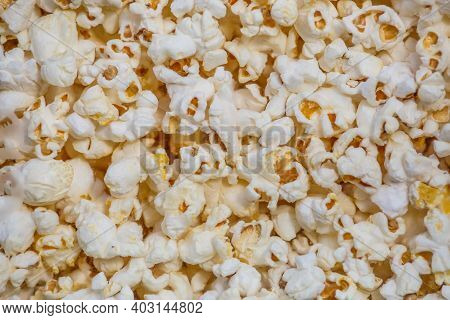 Heap Of Delicious Popcorn, Isolated On White Background. Scattered Popcorn Texture Background. Top V