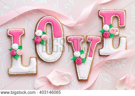 Decorated Valentine cookies spelling the word love