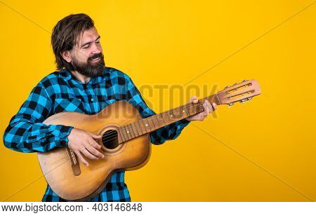 Playing Country Music. Trendy Looking Bearded Hipster Guitarist. Music Concept. Brutal Handsome Man