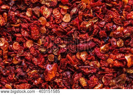 Сrushed Dry Red Paprika. A Mixture Of Different Spices Close Up. Textures Of Colorful Spices And Con