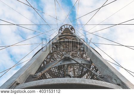 View From Below On The Metal Structure Of The Lookout Tower. Modern Urban Architecture.