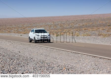 Inyo County, Usa - April 13, 2014: Driving In Death Valley, California. Death Valley National Park W