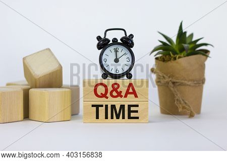 Q And A, Questions And Answers Time Symbol. Concept Words 'q And A Time' On Wooden Blocks On A Beaut