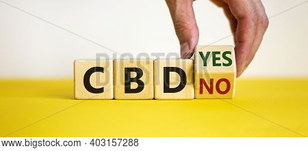 Yes Or No To Cbd, Cannabidiol Symbol. Hand Turns The Cube And Changes Words 'cbd No' To 'cbd Yes'. B