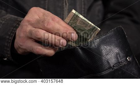 Little Money In The Old Wallet. Last One Dollar Money Banknote In Wallet. Concept: Bankruptcy. Take