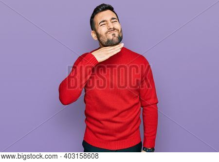 Young hispanic man wearing casual clothes cutting throat with hand as knife, threaten aggression with furious violence