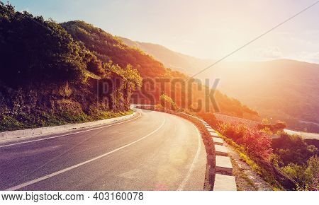 Mountain Road. Beautiful Asphalt Road In The Evening In Summer During Sunset. Vintage Toning. Travel
