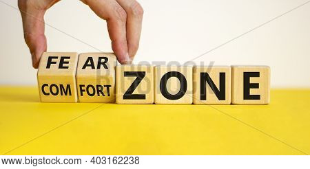 Comfort Or Fear Zone Symbol. Hand Turns Wooden Cubes And Changes Words 'comfort Zone' To 'fear Zone'