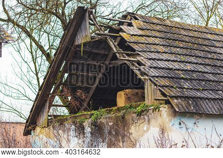 The Roof Of An Old Abandoned Village House Was Destroyed, The House Was Destroyed As A Result Of The