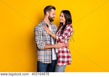 Profile Side View Portrait Of Attractive Cheerful Amorous Couple Embracing Isolated Over Bright Yell